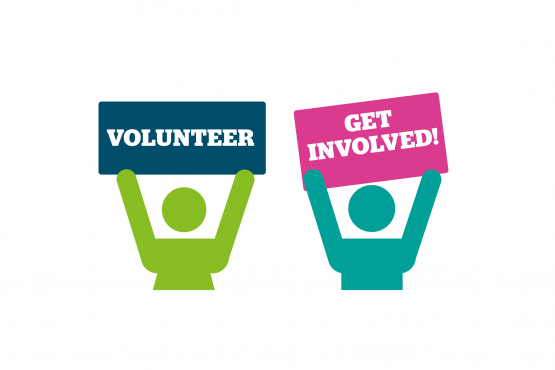 Volunteers holding a Healthwatch poster