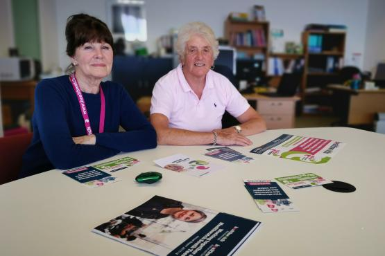 Healthwatch Volunteers sat at a desk